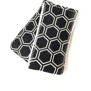 White Honeycomb print on a Black background.
